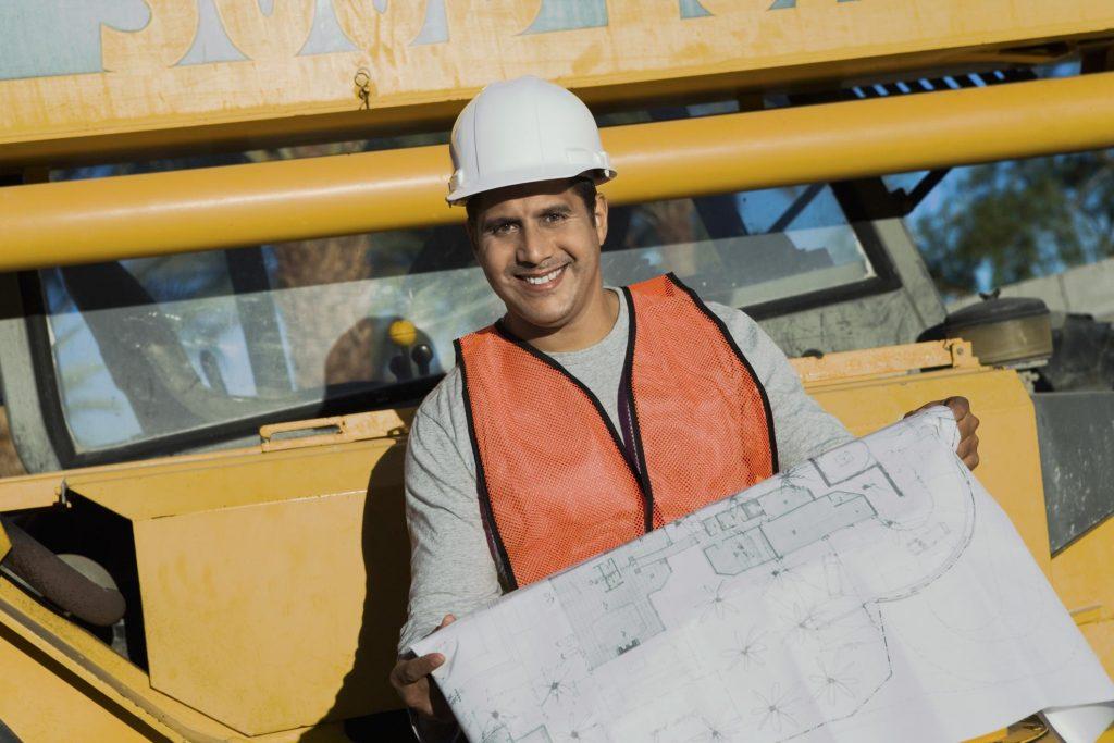 man holding a construction plan