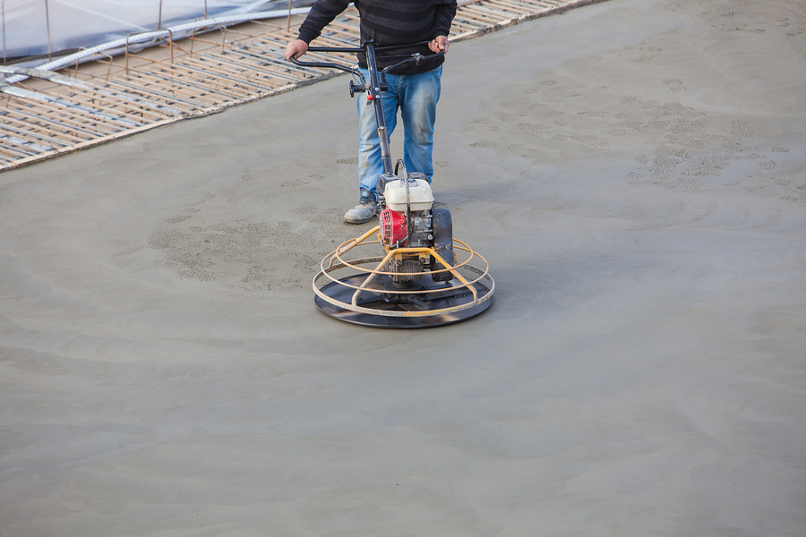 man smoothing the cement