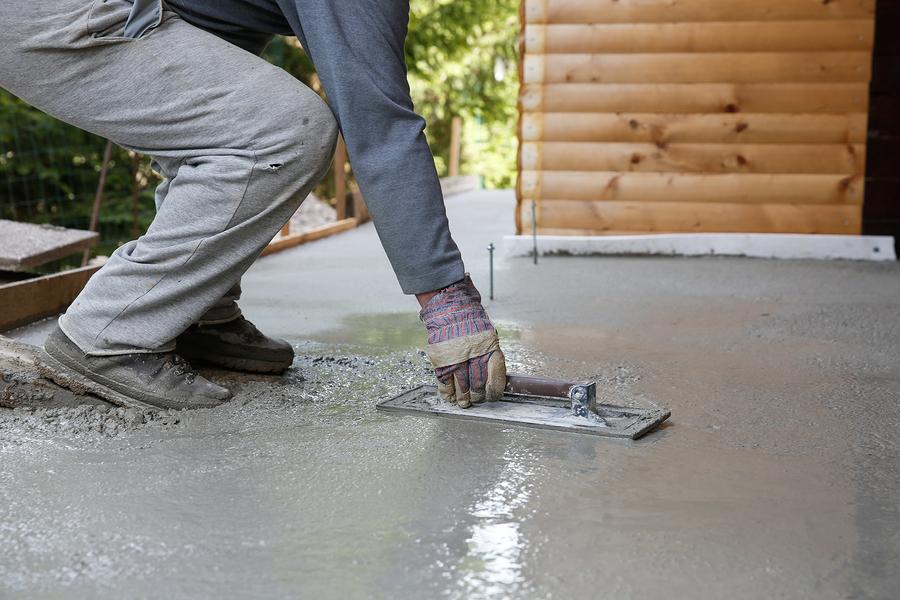 man flattening the cement