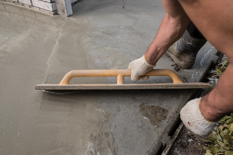 man smoothing out the concrete